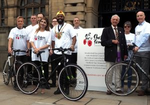Lord Mayor Magid Magid with his new mayoral bike presented by Russell Cutts of Russell's Bicycle Shed as part of South Yorkshire's Love to Ride programme for 2018: Cllr Magid with fellow riders ready for the Sheffield to the Somme charity ride starting on the 20th June to raise money for the Sheffield Memorial Park dedicated to the Sheffield PALS regiments